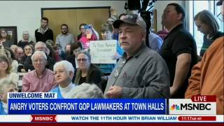 Voter presses Senator Chuck Grassley about Obamacare at Town Hall