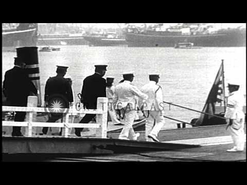 Japanese Emperor Hirohito reviews Japanese Naval battle fleet in Yokohama, Japan. HD Stock Footage