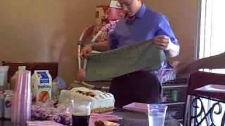 Seth Cuts the Christening Cake