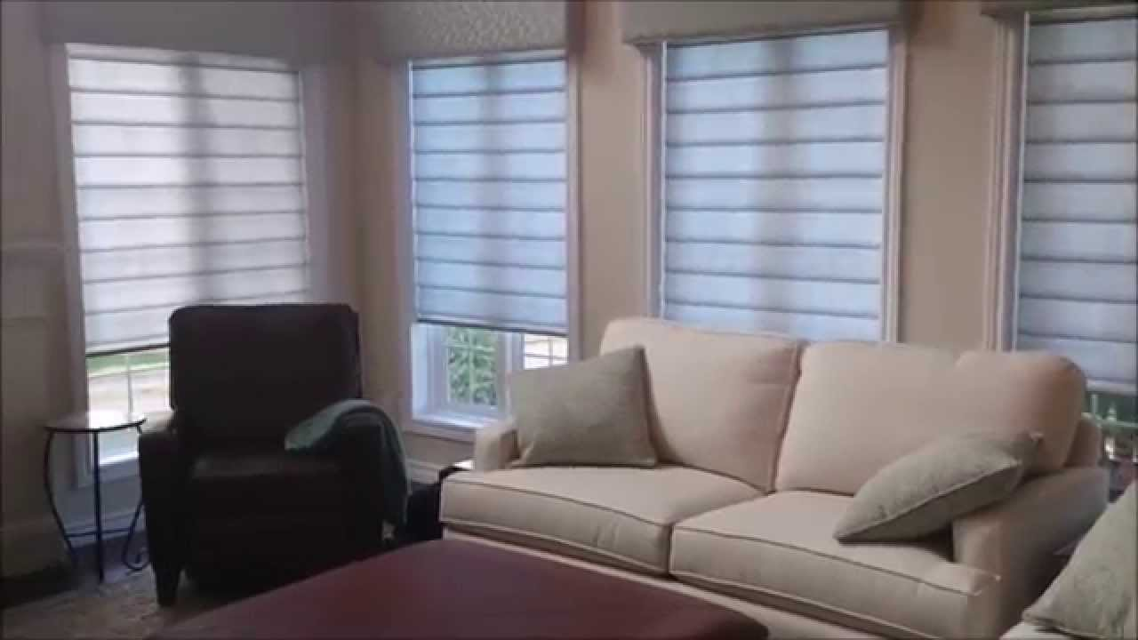 Sun shades of caledon hunter douglas pirouettes with powerview youtube for Hunter douglas exterior sun shades