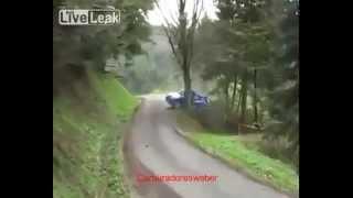 Rally car hits tree sideways