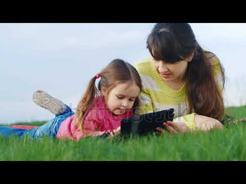 mother and daughter enjoying a picnic tablet