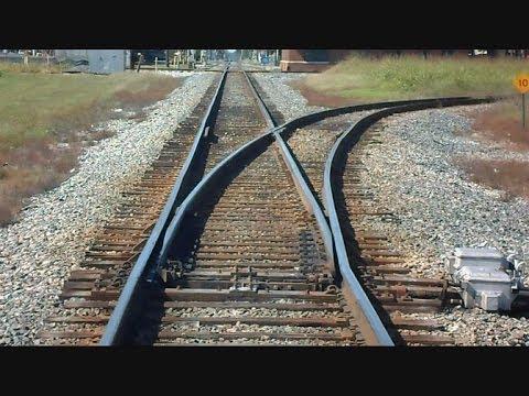 Amtrak Train Passes Track Switches CSX Train Passes