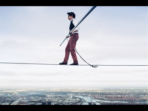 Daredevil Kane Petersen walks between two buildings :: High wire 984ft above Record, Australia 2015