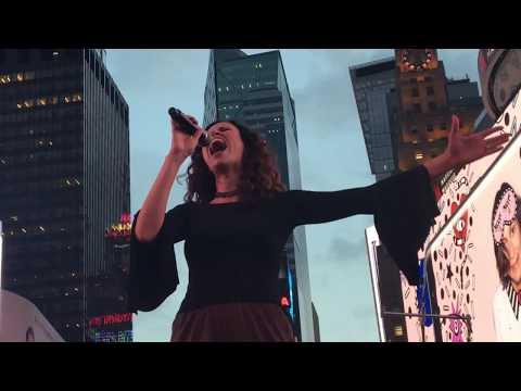 Mandy Gonzalez sings