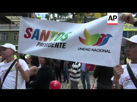Santos marches with supporters in bid to win more votes in second round of elections