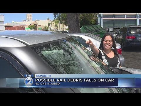 Woman claims car hit by debris from rail construction