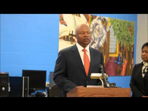 Jim Caldwell speaks at the dedication of new computer lab at Detroit Lions Academy