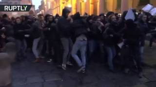 Italian students clash with police in protest over library turnstiles at University of Bologna