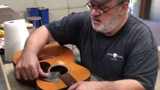 John Reuter removes the neck from a vintage Martin