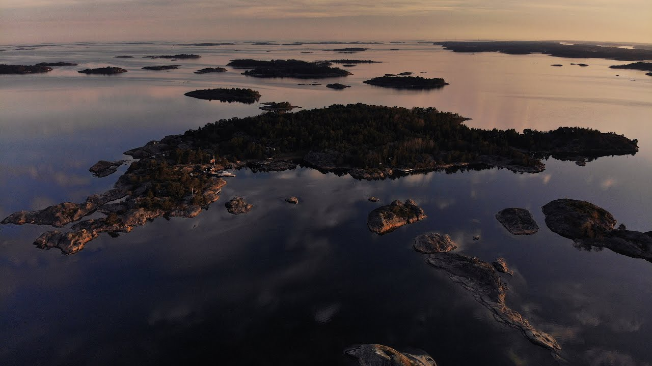 Download Mirror reflections at sunrise in Rosala Archipelago, Finland