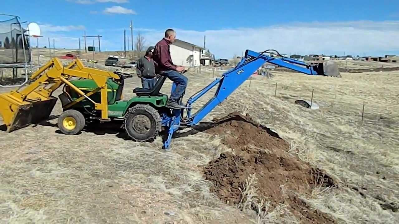 John Deere Backhoe Attachment >> backhoe working on JD 445.MOV - YouTube