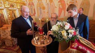 Лукашенко в праздник Пасхи встретился с митрополитом Филаретом и зажег свечу