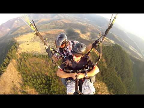 Jamie Robertson paragliding off Woodrat Mountain