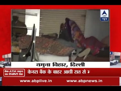 Troubled by cash crisis, people sleep outside bank in Delhi