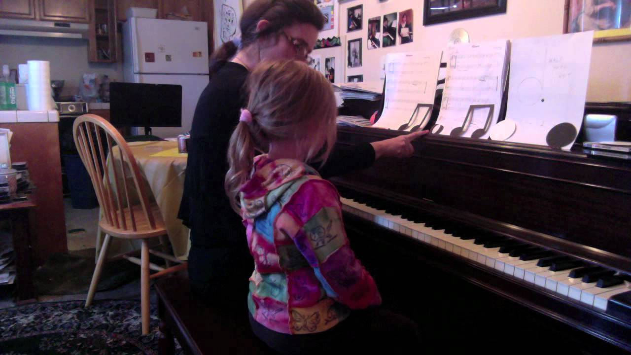 Piano Lesson Rina 5 Shuffles Rhythms On The Music Rack And Claps Them