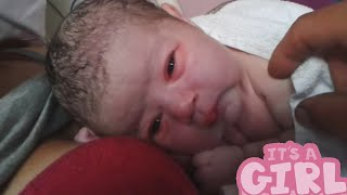 Newborn baby first time opening her eyes
