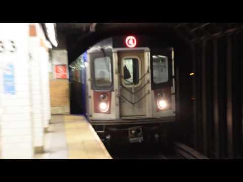 IRT Lexington Av Line: Woodlawn bound 4 local train of R142s leaving 33rd Street