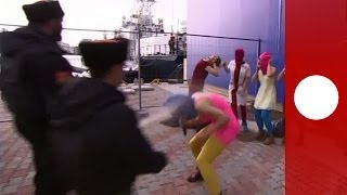 Pussy Riot whipped by Cossack militia in Sochi during performance attempt