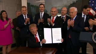 President Donald Trump signs a proclamation recognizing Israeli sovereignty over the disputed Golan Heights.