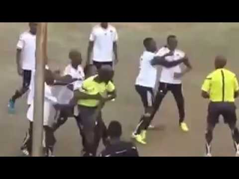 Referee fights Player on football park in Africa