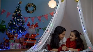 Cute little kid spending quality time with her mom while lying in the tent house - winter season