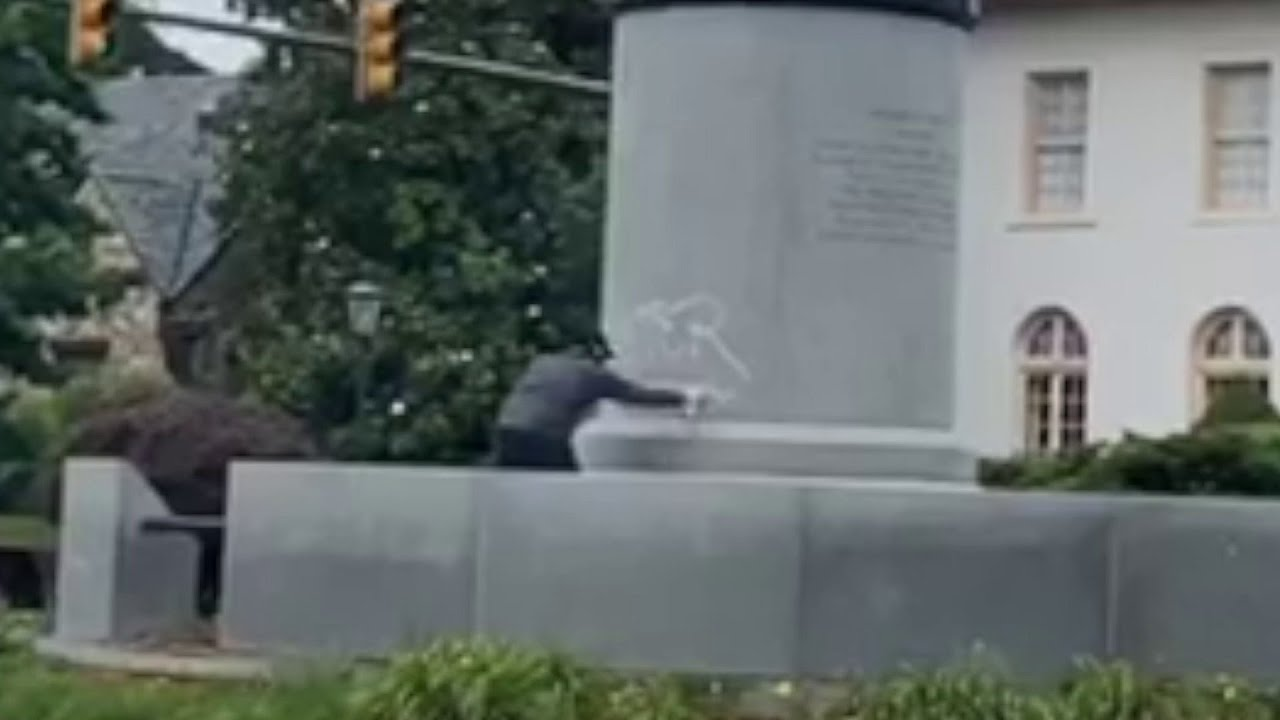White Lives Matter painted on Ashe statue