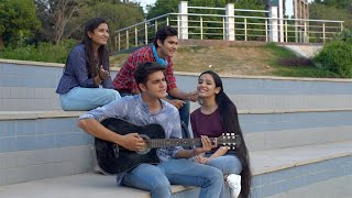 Pan shot of young cheerful friends enjoying college life together in the campus