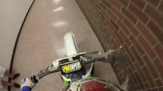 Riding dirt bike through school