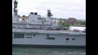 HMS Illustrious leaving the Tyne 2010 with decked Harrier jets.