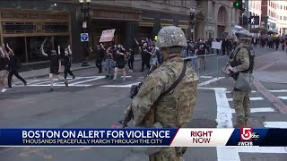 Thousands march through Boston streets under watchful eye of National Guard