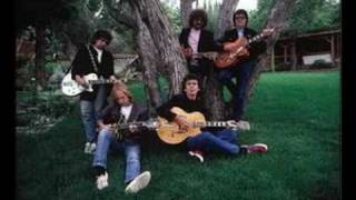 Watch Traveling Wilburys New Blue Moon video