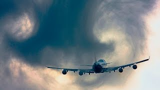 Cloud Busting Plane and Vortices, B747 by KLM