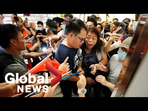 Hong Kong protests: Pro and anti-government demonstrators clash in shopping mall