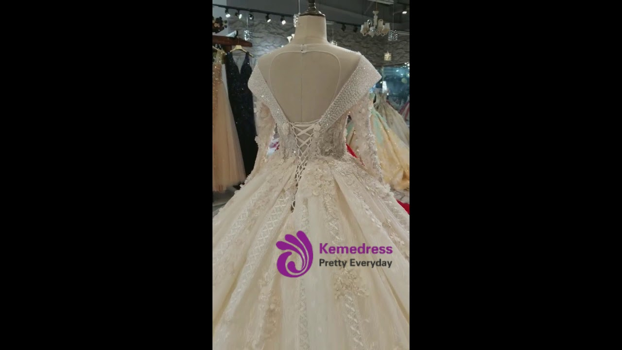 37784ced160cf kemedress Champagne Ball Gown Tulle Appliques Long Sleeve Backless Beading Wedding  Dress