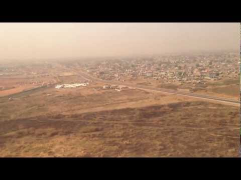 Landing at Juba International Airport in South Sudan -- Huts and UN Aircraft