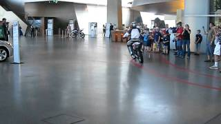 motorcycle driving through the bmw museum in munich germany