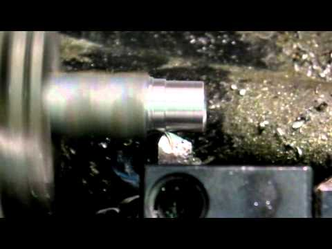 CNC lathe cutting a point on rebar stake