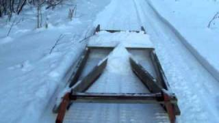 Grooming the ski-doo  trail with homemade drag