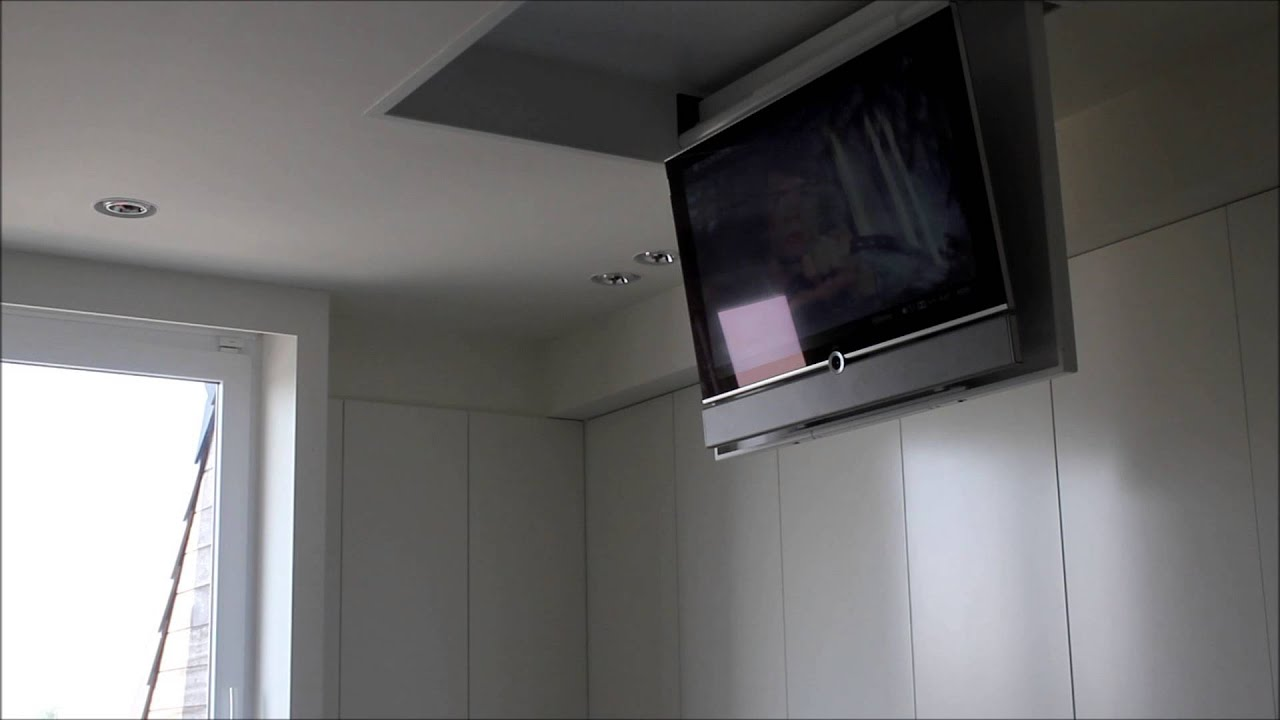 Wegklapbare tv in plafond - YouTube