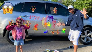 Sally painting Car with colors and wash hands