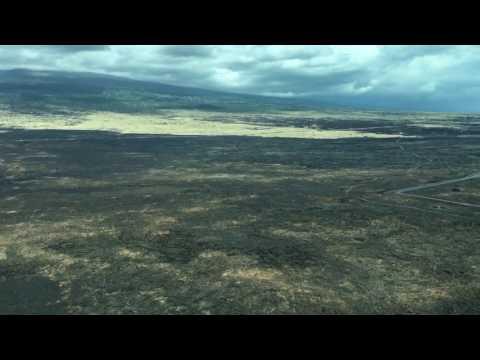 Mokulele Airlines Cessna Caravan final approach over lava field into Kona