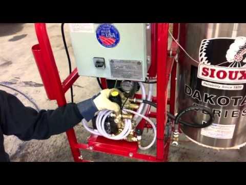 Bill Krokos demonstrates a Sioux steampressure washer combination unit.