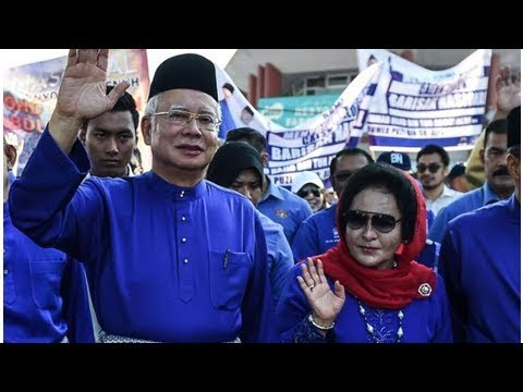 Ex-Malaysian PM Razak, wife banned from leaving country