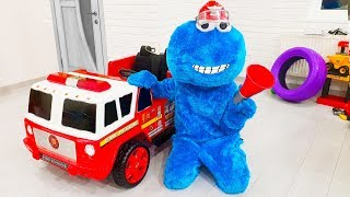 COOKIE MAN plays with his new fire truck