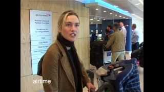 Kate Winslet pushes the luggage as Sam Mendes hold the baby