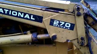 International 270a Backhoe part 7.  Front axle, stabilizer pad and hydraulic hose