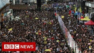 Hong Kong: Police and protesters clash on handover anniversary - BBC News