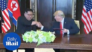 Kim and Trump sign document to complete historic meeting