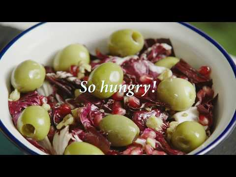 Red-leaved chicory, pomegranate, walnuts salad and olives from Spain